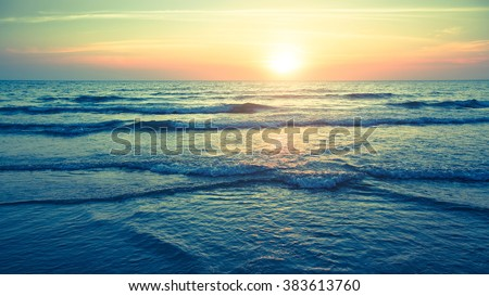 Panorama of beautiful sunset on the ocean. - stock photo