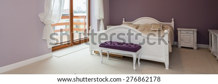 Panorama of bedroom with purple color on wall - stock photo