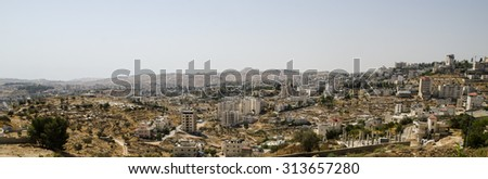Panorama of Bethlehem with Herodium (Herodion) hill at the background. Landmarks for tourists of Israel and Palestine, holy and historic places - stock photo