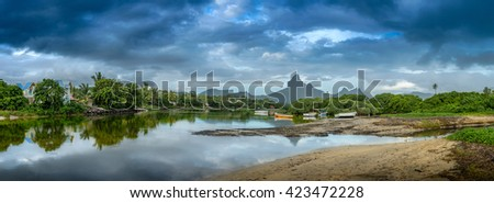 Panorama of Black river Mauritius where the ocean meets the river - stock photo