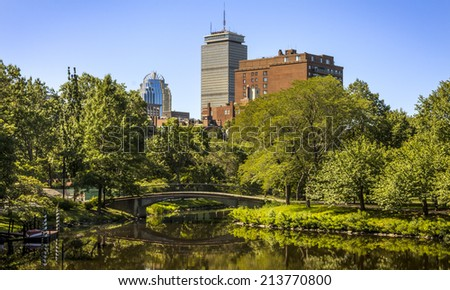 Panorama of Boston in Massachusetts, USA showcasing its landmark skyscrapers in the background and the exuberant and preserved nature around the city on a sunny and warm morning. - stock photo