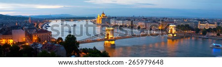 Panorama of Budapest: Hungarian parliament and chain bridge in evening illumination, Hungary - stock photo
