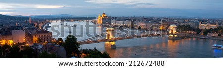 Panorama of Budapest: the Hungarian parliament and the bridge in evening illumination, Hungary - stock photo