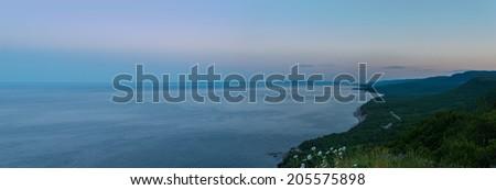 Panorama of Coastal Scene on the Cabot Trail at dusk (Cape Breton, Nova Scotia, Canada) - stock photo