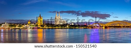 panorama of Cologne city and Rhine river at night, Germany - stock photo