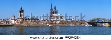 Panorama of Cologne with Great St. Martin Church, Cologne Cathedral, Hohenzollern Bridge and the Rhine river, Germany - stock photo