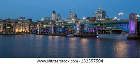 Panorama of colorful blackfriars bridge over the river Thames at dusk, beautifuuly lit in blue and purple In London, capital lof United Kingdom - stock photo