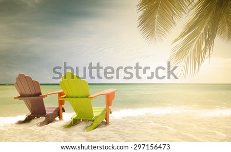 Panorama of colorful lounge chairs at a tropical paradise beach in Miami Florida, desaturated vintage instagram filter for retro looks