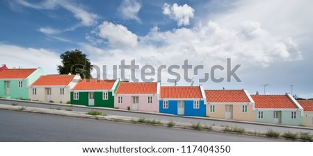 Panorama of colorful row homes. Panorama of colorful row homes build on a hill in Willemstad, Curacao, Netherlands Antilles. - stock photo