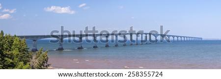 Panorama of Confederation Bridge to Prince Edward Island, view from New Brunswick coast in Canada. - stock photo