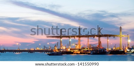 Panorama of Container stacks and crane in shipyard at dusk for cargo Goods and Logistic background - stock photo