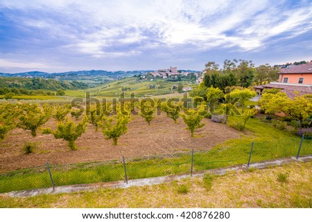 panorama of cultivated fields on the hills of Emilia Romagna dominated by Malatestian Castle,  medieval fortress dating back to 1200 AD, of Longiano, Italy