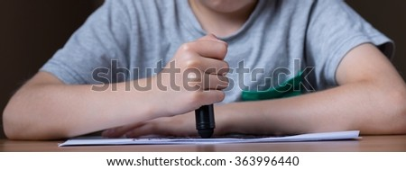 Panorama of depressed child with problem holding blacck crayon - stock photo