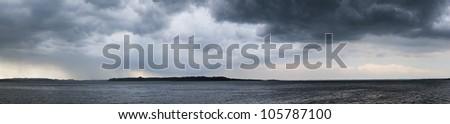 panorama of dramatic mood before storm at lake chiemsee - stock photo