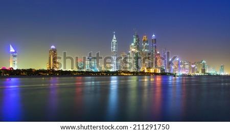 Panorama of Dubai city at night, United Arab Emirates - stock photo