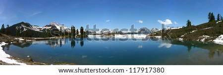 Panorama of Elfin Lakes on top of diamond head in Garibaldi National Park in British Columbia during spring - stock photo