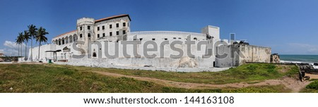 Panorama of Elmina Castle (also called the Castle of St. George) which is located on the Atlantic coast of Ghana west of the capital, Accra. It is a UNESCO World Heritage Site. - stock photo