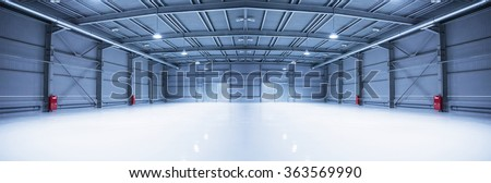 Panorama of empty room of modern storehouse with gates - stock photo
