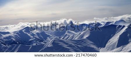 Panorama of evening mountains. Caucasus Mountains, Georgia. Ski resort Gudauri. - stock photo