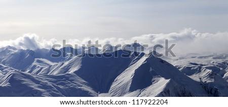 Panorama of evening mountains in haze. Caucasus Mountains, Georgia, Gudauri. - stock photo