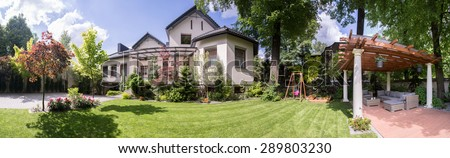 Panorama of exclusive residence with beauty gazebo - stock photo