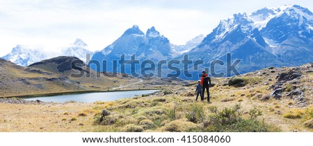 panorama of family hiking in beautiful torres del paine national park, patagonia, chile, active travel concept - stock photo