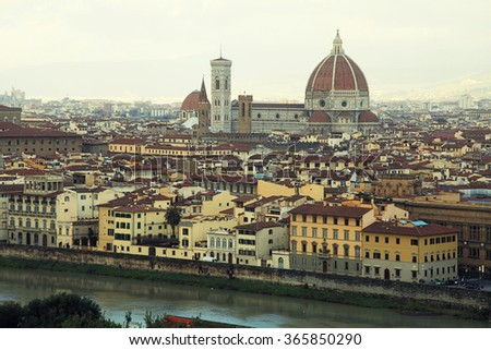 Panorama of Florence in Italy with the Dome of the Cathedral and Arno River. Vintage toned image, winter landscape - stock photo