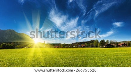 Panorama of German countryside and village on sunset with sun. Bavaria, Germany - stock photo
