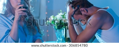 Panorama of girlfiend breaking up with her boyfriend during dinner - stock photo