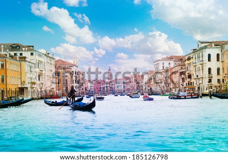 Panorama of grand canal with boats, gondolas and gondoliers on sunny summer day in Venice, Italy - stock photo