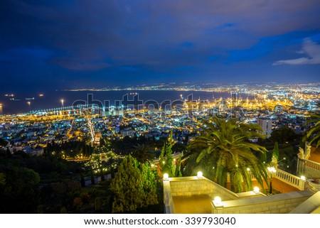 Panorama of Haifa - port and Bahai garden at night, Israel - stock photo