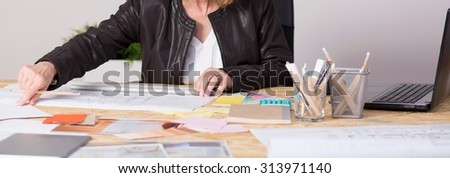 Panorama of hard working mature woman leading family business - stock photo