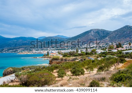 Panorama of Hersonissos town in Crete, Greece and mountains.
