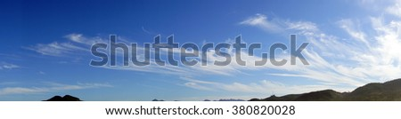 Panorama of high cirrus clouds over Seaside, Oregon coast