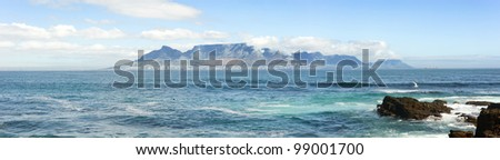Panorama of iconic Table Mountain, a famous tourist destination in Southern Africa with plenty of copyspace - stock photo