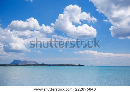 Panorama of idyllic beach with turquoise water on beautiful summer day - stock photo