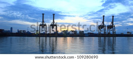 Panorama of Industrial Container Cargo freight ship with working crane for Logistic Import Export - stock photo