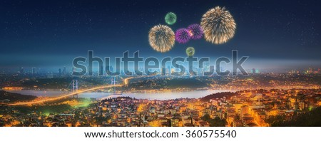 Panorama of Istanbul and Bosphorus bridge with fireworks at night, Istanbul, Turkey - stock photo