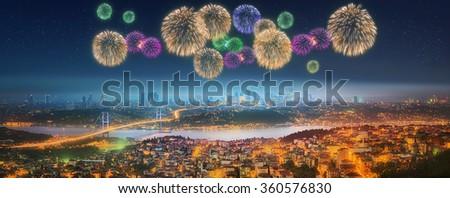 Panorama of Istanbul and Bosphorus bridge with fireworks at night, Istanbul, Turkey - stock photo