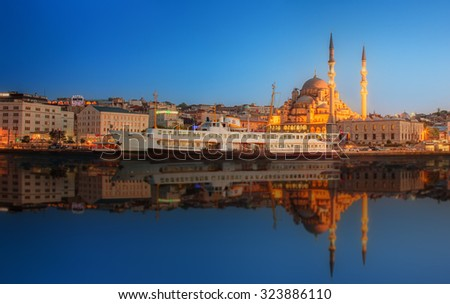 Panorama of Istanbul at a dramatic sunset from Galata Bridge, Istanbul, Turkey - stock photo