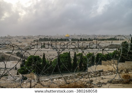 Panorama of Jerusalem with barbed wire in the foreground. Israel - stock photo