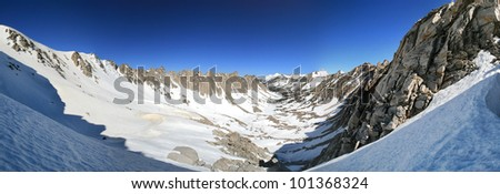 panorama of Kearsarge Lakes Basin in the Sierra Nevada covered in snow - stock photo