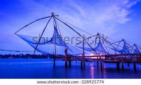 Panorama of Kochi tourist attraction -  chinese fishnets on sunset. Fort Kochin, Kochi, Kerala, India - stock photo