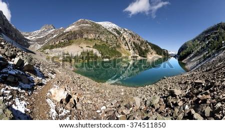 Panorama of Lake Agnes, Mount St. Piran, Lake Louise, Banff National Park, Alberta, Canada Picture taken on August 22, 2015 - stock photo