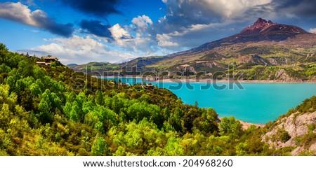 Panorama of lake Serre-Poncon, Alps, France. - stock photo