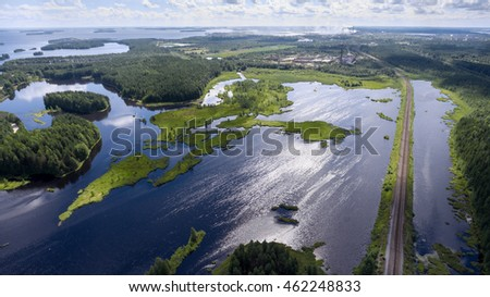 Panorama of lakes and forests of Karelia with the railway passing to the town of Segezha, Karelia, Russia