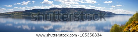 Panorama of Loch Ness with reflecting clouds, Scotland, United Kingdom - stock photo