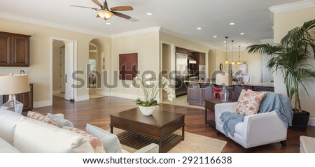 Panorama of luxury home living room with kitchen - stock photo