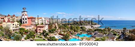 Panorama of luxury hotel and Playa de las Americas at background, Tenerife island, Spain - stock photo