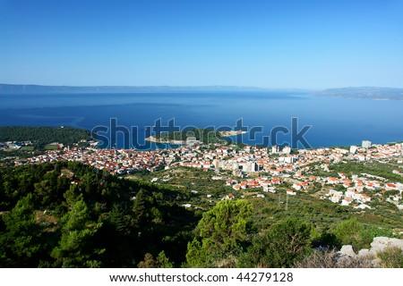 Panorama of Makarska and coastline with beautiful blue sea. - stock photo